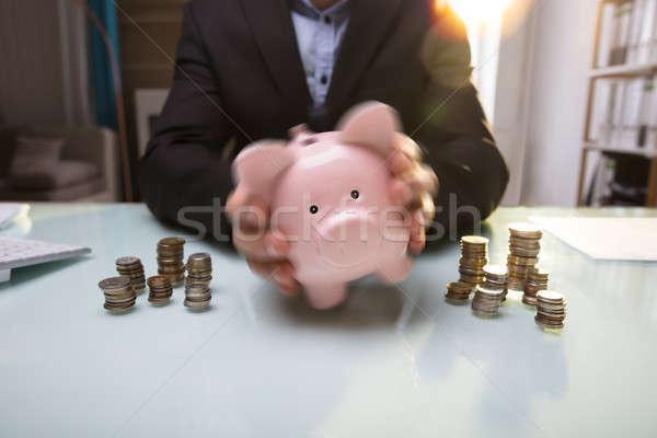 Businessperson's Hand Shaking Piggy Bank Stock photo © AndreyPopov