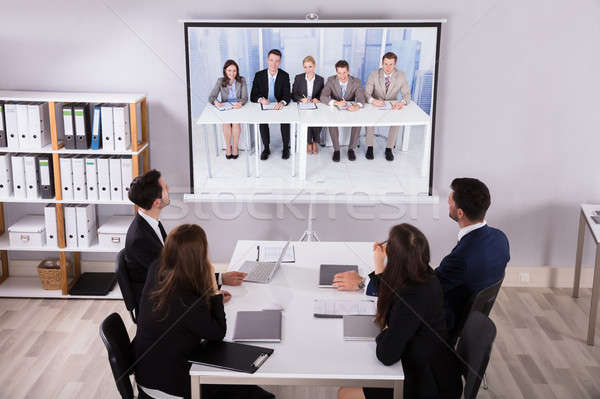 Group Of Businesspeople Looking At Projector Stock photo © AndreyPopov
