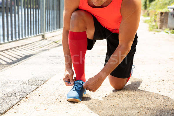 Male Athlete Tying Shoelace Stock photo © AndreyPopov