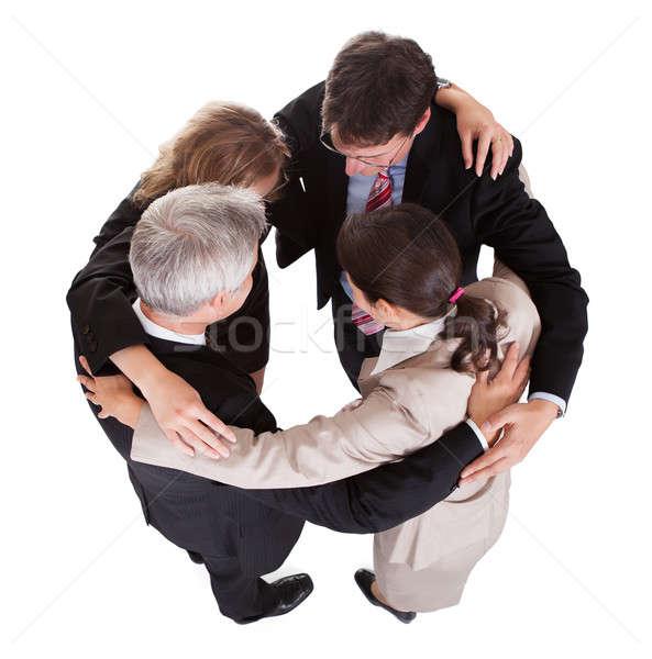 Stock fotó: üzletemberek · kéz · a · kézben · csapatmunka · csoport · négy · sokoldalú