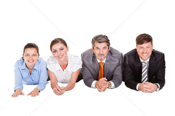 Businesspeople Lying On Front Stock photo © AndreyPopov