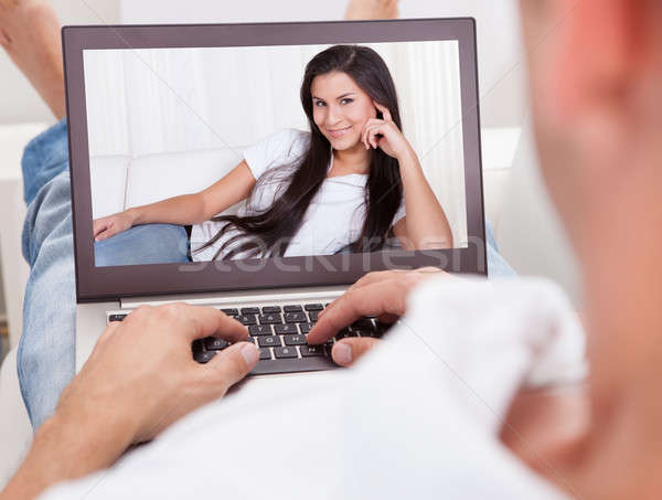 Man Having A Videochat With Woman Stock photo © AndreyPopov