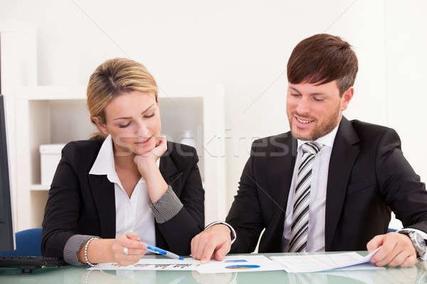 Business partners discuss sales Stock photo © AndreyPopov