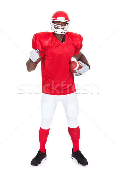 American Football Player Holding Rugby Ball Stock photo © AndreyPopov