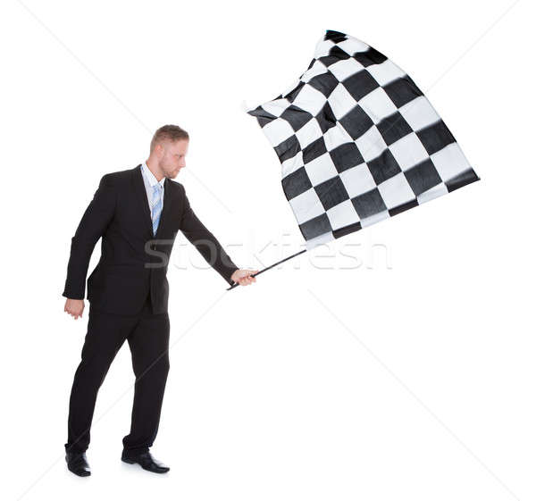 Conceptual image of a stylish young businessman waving a flag Stock photo © AndreyPopov