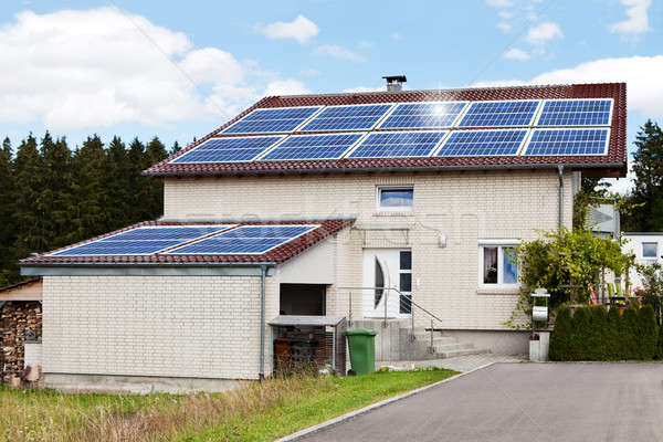 House With Solar Panels On Roof Stock photo © AndreyPopov