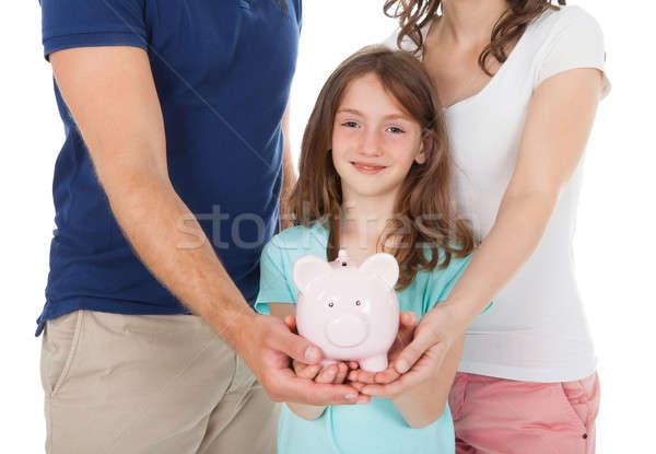 Family Holding Piggy Bank Stock photo © AndreyPopov