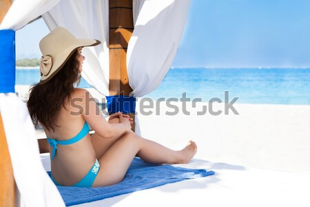 Young woman relaxing in gazebo at beach Stock photo © AndreyPopov