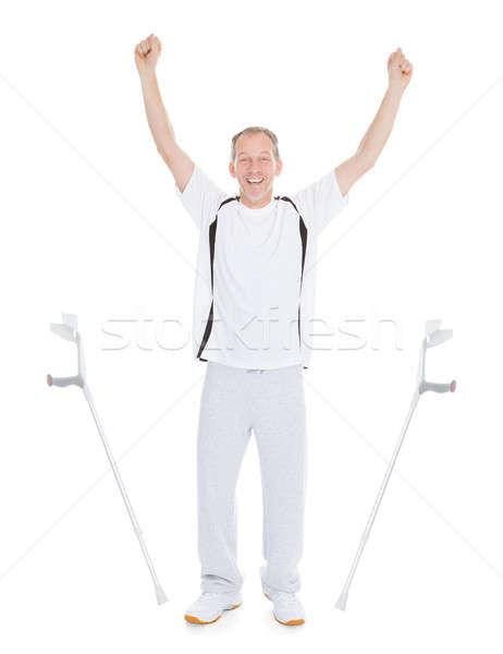Opgewonden volwassen man krukken witte man gelukkig Stockfoto © AndreyPopov