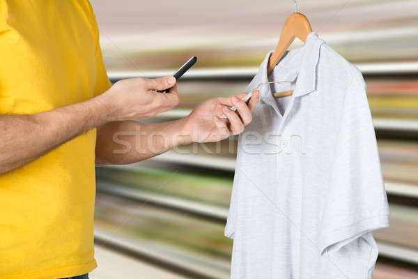 Man Scanning The Price Tag For Shopping Stock photo © AndreyPopov