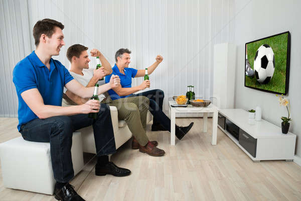 Three Men Watching Soccer Match Stock photo © AndreyPopov