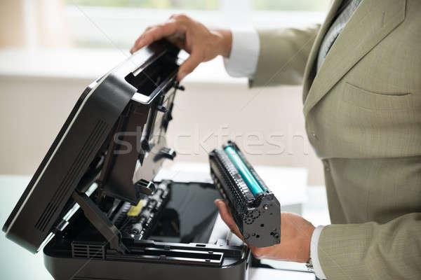 Businessman Fixing Cartridge In Photocopy Machine Stock photo © AndreyPopov