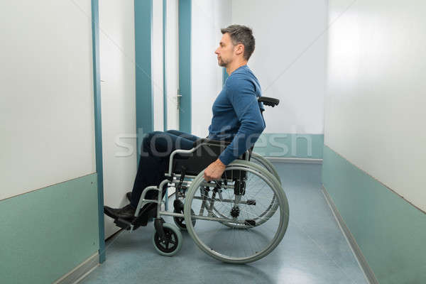 Disabled Man Entering In Room Stock photo © AndreyPopov