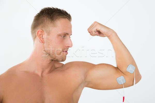 Foto stock: Homem · braço · retrato · moço · músculo · corpo