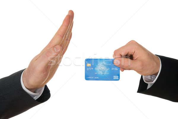 Businessman Avoiding Credit Card Stock photo © AndreyPopov