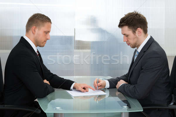 Businessman Signing A Contract Stock photo © AndreyPopov