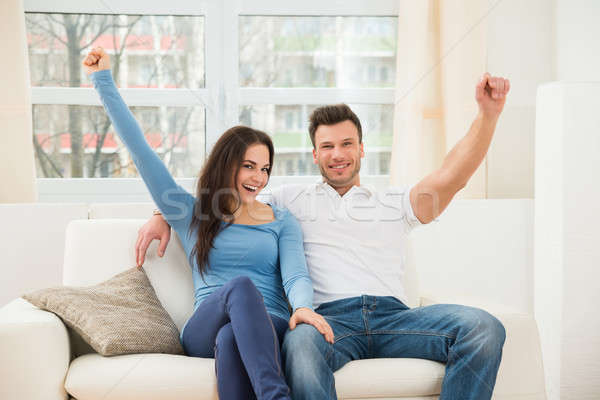 Excited Smiling Couple Stock photo © AndreyPopov