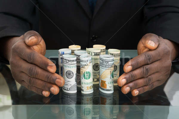 Businessman Hands Protecting Banknotes Stock photo © AndreyPopov