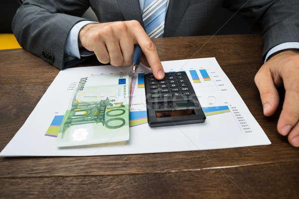 üzletember grafikon iroda közelkép kezek számológép Stock fotó © AndreyPopov