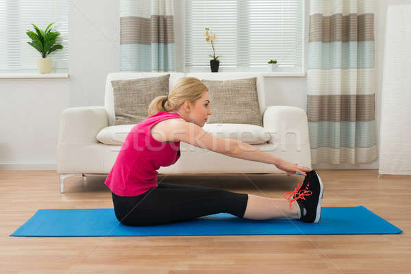 Woman Doing Workout Stock photo © AndreyPopov