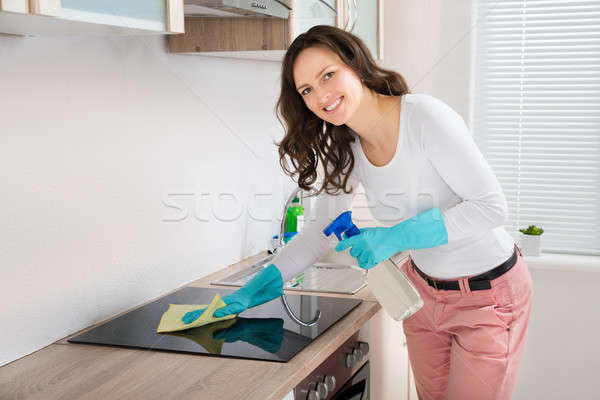 Woman Cleaning Induction Hob Stock photo © AndreyPopov