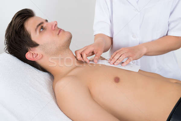 Beauty Therapist Waxing Man's Chest Stock photo © AndreyPopov