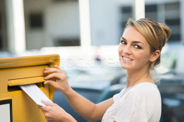 Woman Inserting Letter In Mailbox Stock photo © AndreyPopov