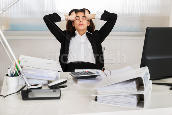 Tensed Accountant Sitting At Desk In Office Stock photo © AndreyPopov