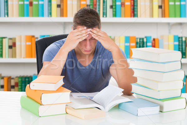 Tensed University Student Sitting In Library Stock photo © AndreyPopov