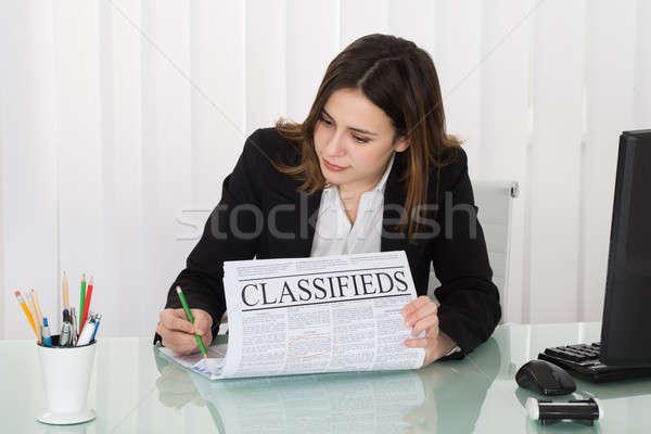 Businesswoman Highlighting Advertisement On Newspaper Stock photo © AndreyPopov