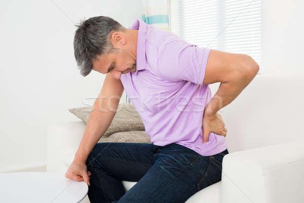 男 腰痛 座って ソファ 成熟した男 壁 ストックフォト © AndreyPopov