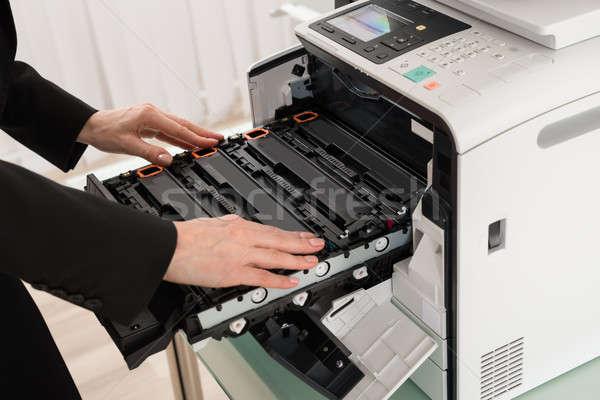 Businesswoman Hand Fixing Copy Machine Stock photo © AndreyPopov