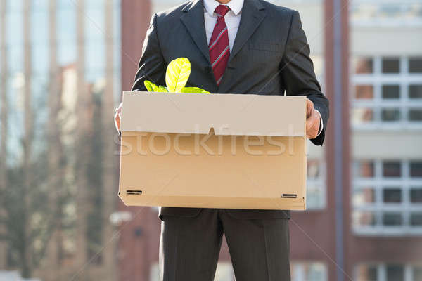 Close-up Of Businessperson Standing With Cardboard Box Outside O Stock photo © AndreyPopov
