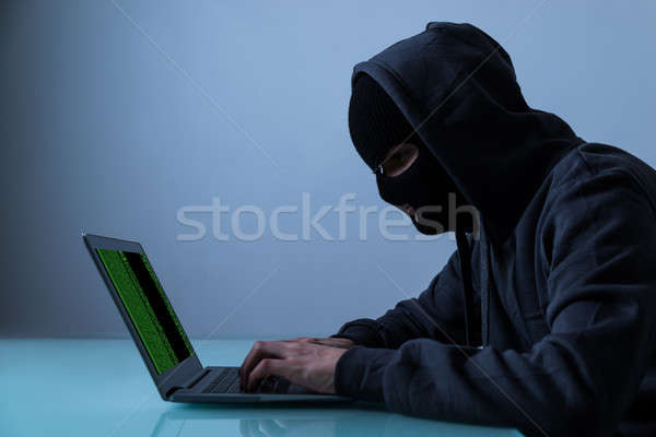 Hacker Stealing Information From Laptop Stock photo © AndreyPopov