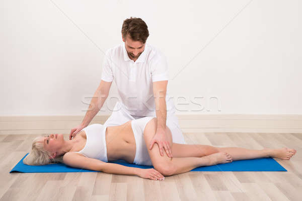 Woman receiving chiropractor massage Stock photo © AndreyPopov