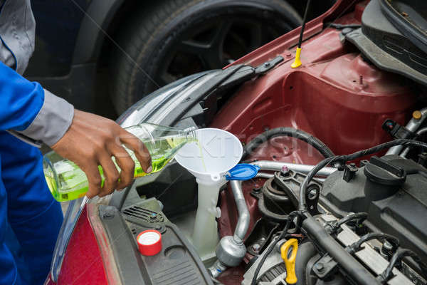 Mechanic Pouring Oil Into The Car Engine Stock photo © AndreyPopov
