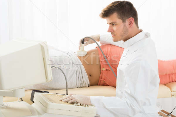 Woman Getting Ultrasound From Doctor Stock photo © AndreyPopov