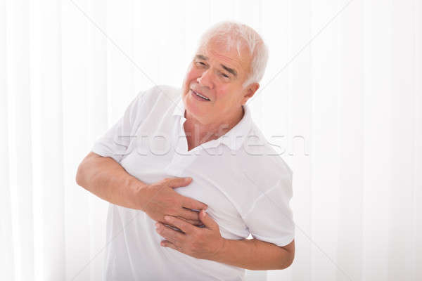 человека страдание сердечный приступ стороны груди дома Сток-фото © AndreyPopov