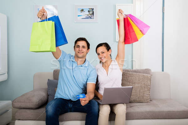 Couple Holding Multi-colored Shopping Bags Stock photo © AndreyPopov