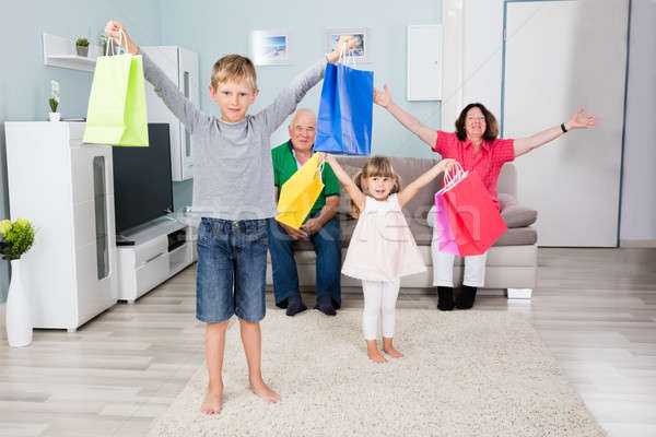 Grandchildren Holding Shopping Bag At Home Stock photo © AndreyPopov