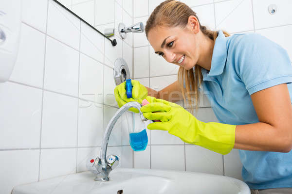 Woman Cleaning The Basin Tap Using Spray Bottle Stock photo © AndreyPopov