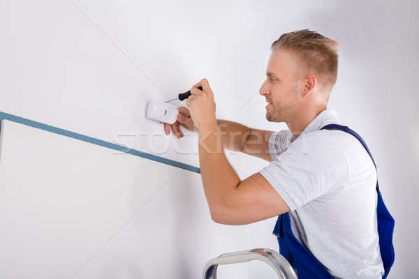 Man Installing Motion Detector For Security System Stock photo © AndreyPopov