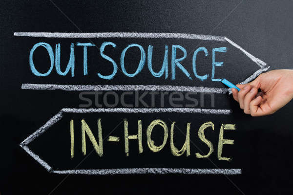 In-house Or Outsource Concept Drawn On Blackboard Stock photo © AndreyPopov