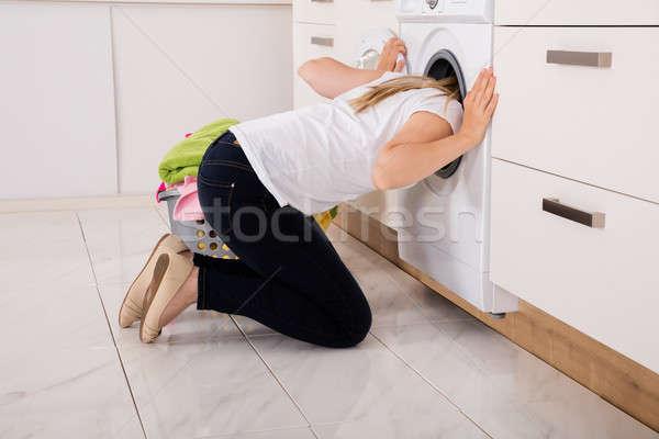 женщину внутри стиральная машина кухне технологий Сток-фото © AndreyPopov