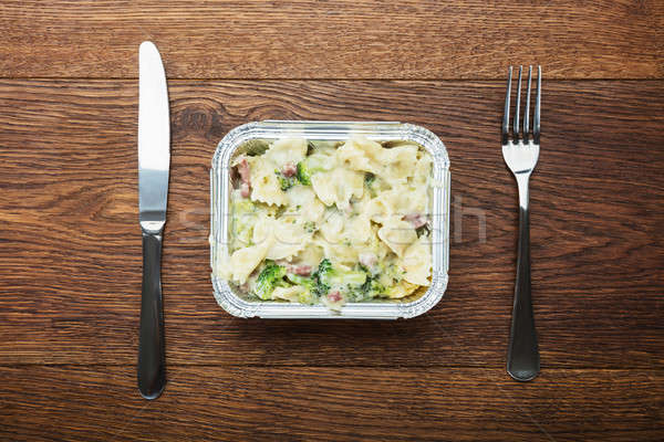 Ready Pasts Meal In Foil Container On The Table Stock photo © AndreyPopov
