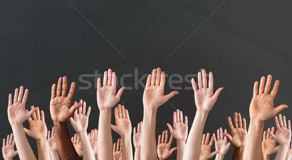 Close-up Of Raised Hands Stock photo © AndreyPopov