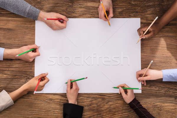 High Angle View Of Businesspeople Hand With Pencil Stock photo © AndreyPopov