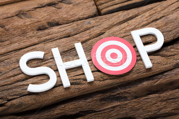 Shop Text With Dartboard On Wooden Table Stock photo © AndreyPopov