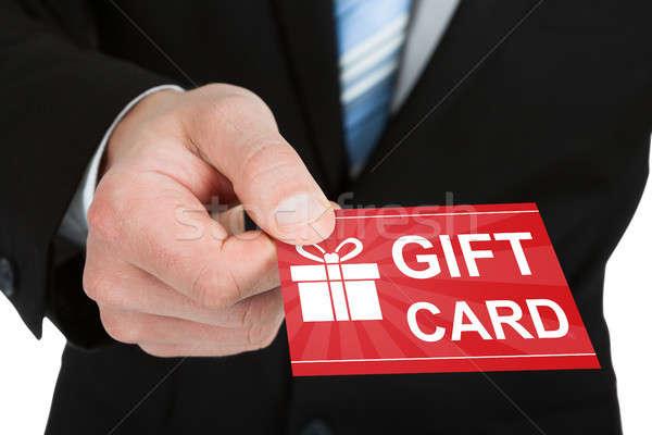 Empresario mano rojo tarjeta de regalo primer plano traje Foto stock © AndreyPopov