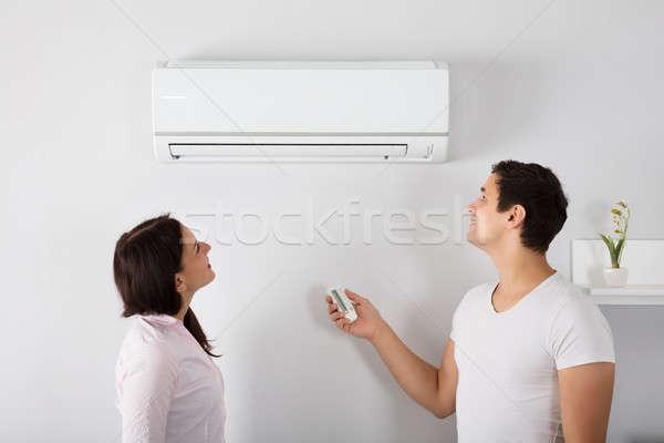 カップル 温度 空調装置 幸せ 家 ストックフォト © AndreyPopov